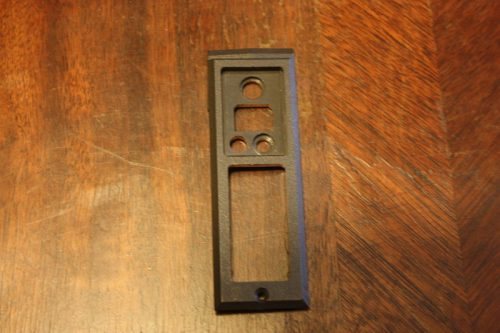 Transmit button side plate